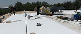 Commercial flat roof construction. Repair and replace